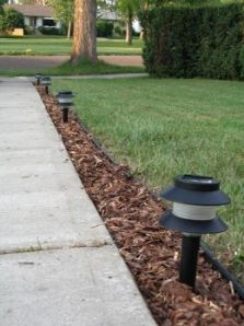 Landscape Lighting Nashville Outdoor Lighting Perspectives Page - Brick column lit by flush mounted core drilled well light