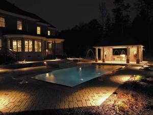 Another well lit pool house/cabana and pool area