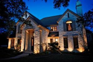 Outdoor Lighting Perespectives of Nashville uses architectural lighting to accentuate this homes distinctive features