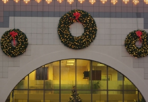 This business welcomes patrons with a trio of elegant wreaths spreading holiday cheer.