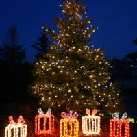 Nashville tree lighting with lit presents underneath