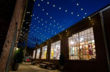 Another look at how festoon lighting enlivens this commercial space.