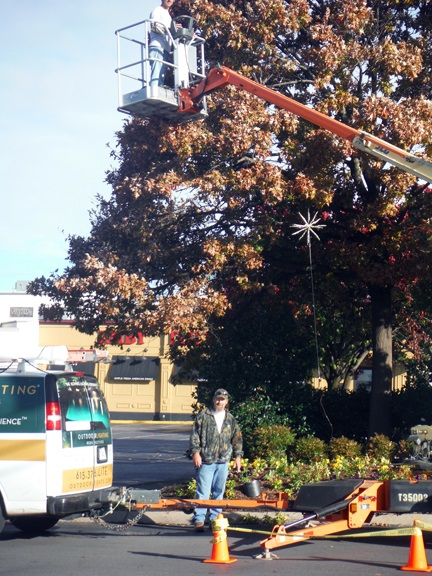 Xmas OLP Nashville installing holiday lighted starbursts at Green Hills Mall Nashville