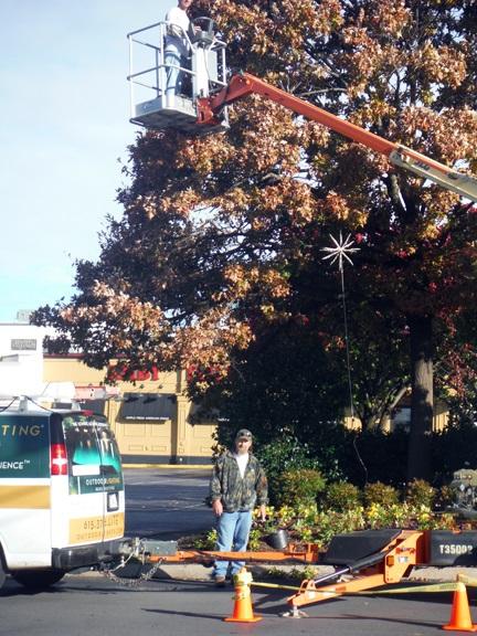 Xmas OLP Nashville installing holiday lighted starbursts at Green Hills Mall Nashville