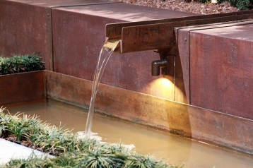 Deck BB02 used under fountain in entry garden by Anne Daigh landscape architect,LLC at Nasheville Antiques and Garden Show