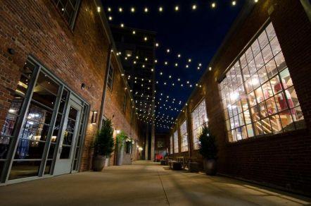 Festoon style permanent festival lighting in the Gulch.